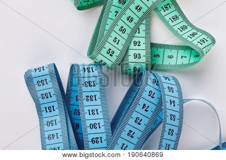 Two measuring tapes, white background. Colorful measuring objects. Measuring for your design.
