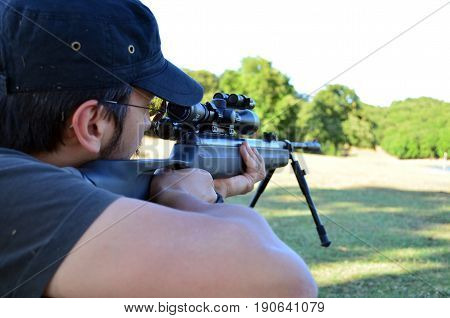 engaging gun rifle  sniper huntingmen landscape trees forest shooting men
