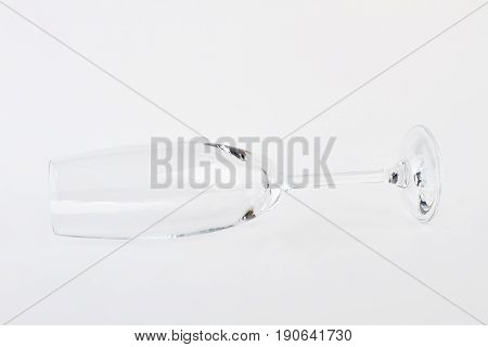 Single champagne flute isolated on white. Blank fragile wineglass.