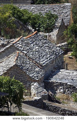 old stone houses with grey stone shingle in Splitska on the Brac island Croatia