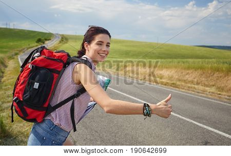 girl holding map with backpack in the road and Tuscany background, Relax time on holiday concept travel