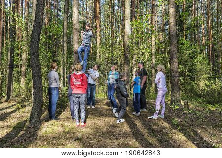 Belarus, Minsk - 05/13/2016: On a tight rope a man with harness