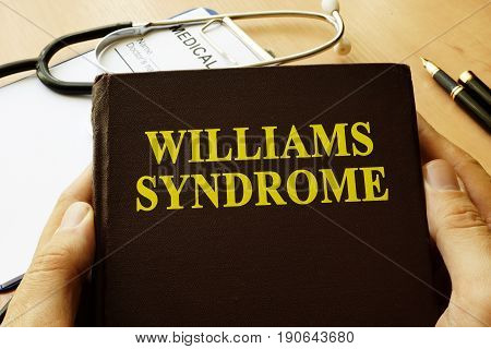 Book with title Williams Syndrome on a table.