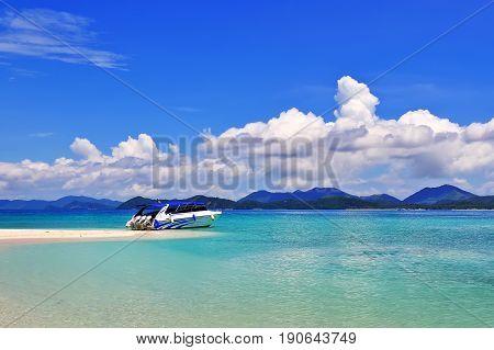 Beach with speedboat khai island indian ocean