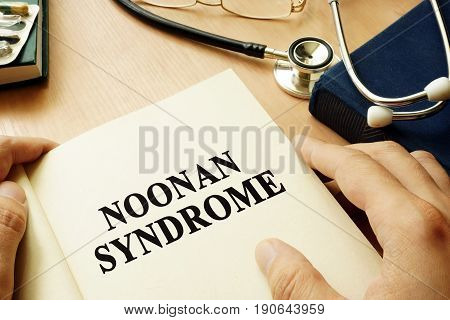 Book with title Noonan Syndrome on a table.