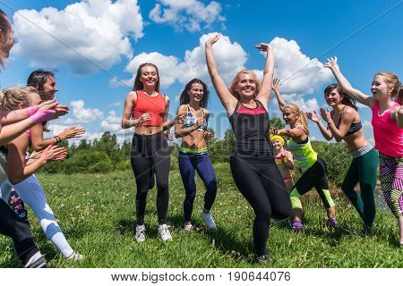 Group of fit womem runners finishing People applauding