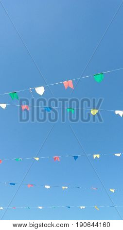 Rows of colorful flags on the blue sky background
