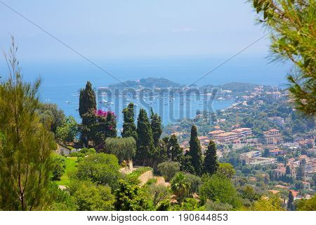 Beautiful Nature Landscape of the Alpes-Maritimes. Aerial View of bay Luxury resort Villefranche-sur-Mer on French Riviera at Mediterranean Sea. Amazing Horizontal wallpaper. Europe. France.