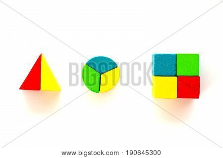 Colorful wooden toy block compose by piece to triangle circle and square shape on white background