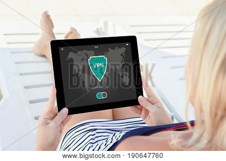 woman holding tablet with app vpn creation Internet protocols for protection private network