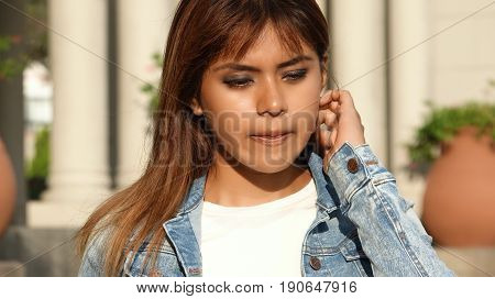 Confused Latina Female Wearing a Jean Jacket