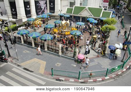 View Of Erawan Shrine And People Praying Thao Maha Phrom Or Lord Brahma At Ratchaprasong