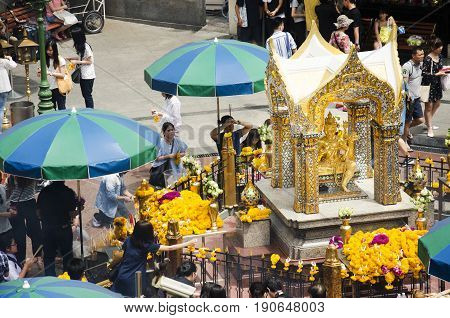 View Of The Hindu Shrine From Bts Skytrain And Thai And Foriener People Praying Thao Maha Phrom Or L