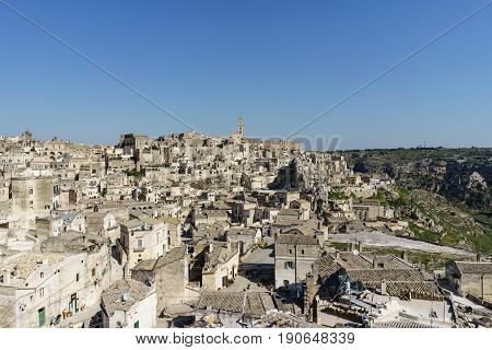 beauty of ancient ghost town of Matera (Sassi di Matera) in bright sun shine summer with blue sky south Italy.