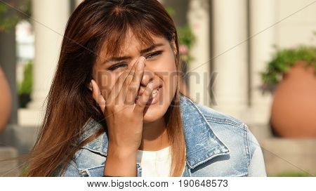 Tearful Young Female Wearing a Jean Jacket