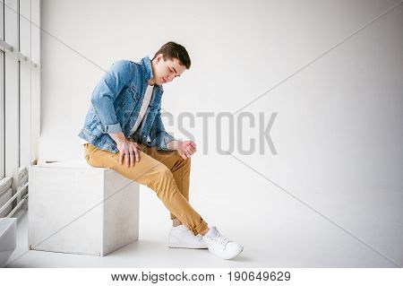 Young Handsome Man Of Strong Athlete's Body, Dressed In Blue Jeans Jacket In Style Of Old School And