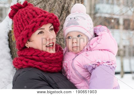 Beautiful Mom And Nice Baby Outdor In A Winter