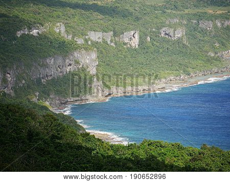 High cliffs and blue waters, Rota High cliff lines border the blue waters of Rota, Northern Mariana Islands
