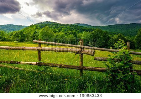 wooden fence on hillside in the rural area. classic countryside landscape of Carpathians