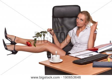 Businesswoman with red rose sits on armchair on a white background.