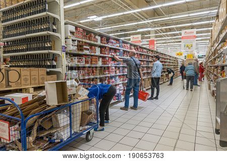 RUSSIA, MOSCOW, JUNE 11, 2017: People Shopping for diverse products in Auchan supermarket Moscow