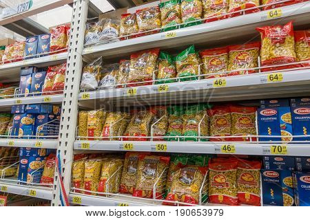 RUSSIA, MOSCOW, JUNE 11, 2017: Different types of Macaroni and pasta on the shelves in the supermarket Auchan.