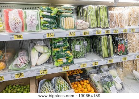RUSSIA, MOSCOW, JUNE 11, 2017: Different types of products on the shelves in the supermarket Auchan.