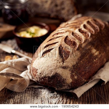 Rustic sourdough spelled bread on wooden table