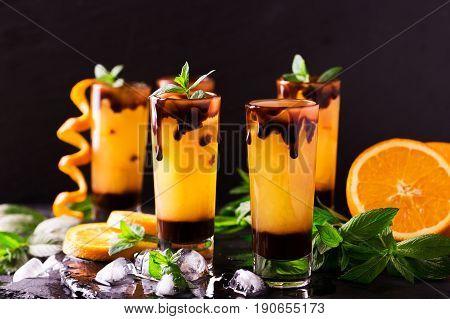 Aperitif With Vodka, Orange Juice, Chocolate And Mint.