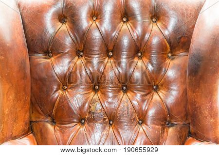 Brown leather upholstery background. Chesterfield sofa. Pattern.