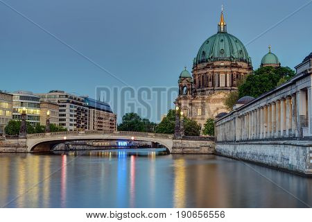 The Berlin cathedral at the banks of the river Spree at dusk