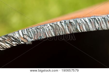 Accident on the aqueduct. Repair of the pipe. The incision is blown. Macro shooting. Colors are brown gray green silver