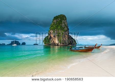 Wooden Boats And A High Cliff In The Sea, Thailand, Phra Nang Beach