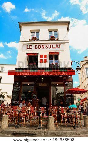 PARIS , France- June 01, 2017: View of typical paris cafe in Paris. Montmartre area is among most popular destinations in Paris, Le Consulat is a typical cafe.