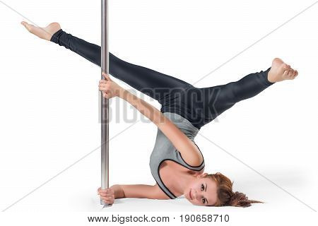 Active Flexible Girl With A Pylon Engaged In Training On A White Background