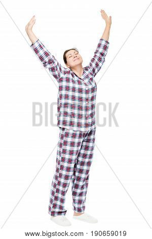 Stretched Girl In Pajamas On A White Background In Full Length