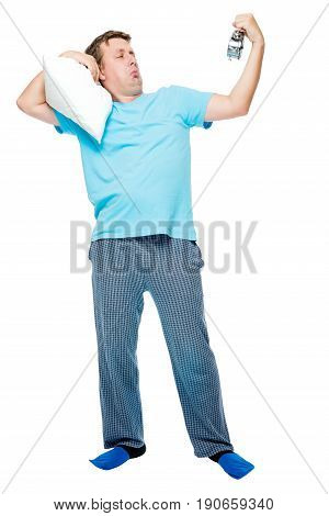 Sleepy Man In Pajamas With Pillow And Alarm Clock On White Background