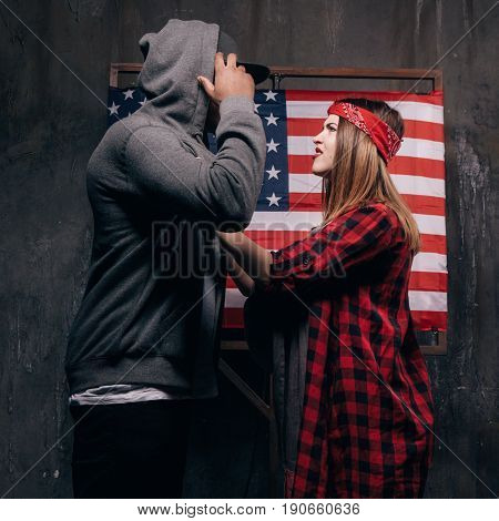 Jealousy in the American family. Conflict. Wife and husband on USA national flag background. Divorce, social problem, violence, youth pregnancy concept