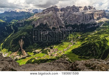 high Badia Valley -Colfosco village aerial view from Mt Sassongher Alto Adige Italy