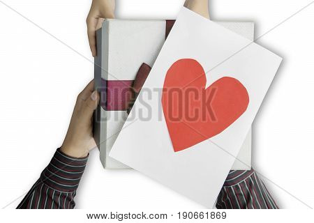 Close up of daughter hands giving a gift and love card to father isolated on white background