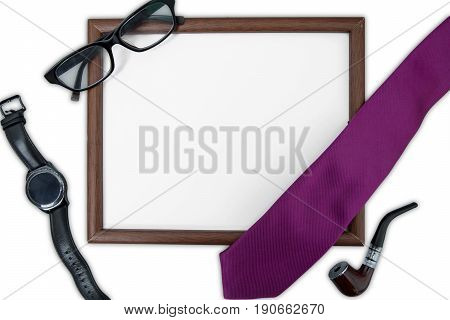 High angle view of an empty frame with wristwatch tie glasses and smoke pipe isolated on white background