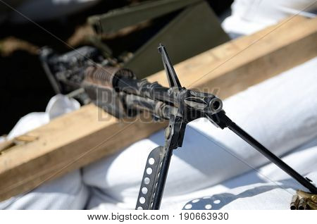 WROCLAW POLAND - JUNE 3: Reconstruction groups rally. Militarians fan gathering people in uniforms historical vehicles and weapons. Old machine gun from World War II on June 3rd 2017 in Wroclaw.