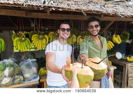 Man Couple Drink Coconut Cocktail On Street Traditional Fruits Market, Young Guys Travelers