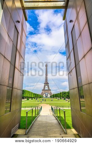 The Eiffel Tower in the day lights, Paris, France, a popular attraction for tourists.