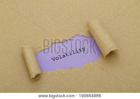VOLATILITY word written under torn paper .