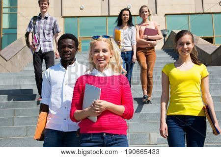 Group of diverse students outside smiling together