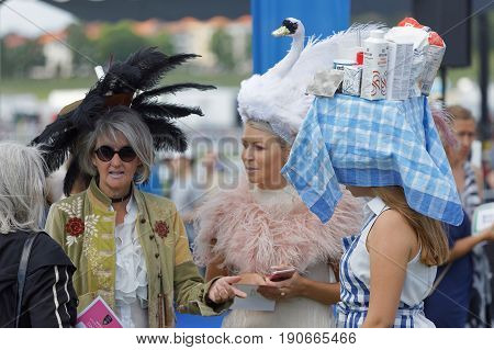 STOCKHOLM SWEDEN - JUNE 06 2017: Hat parade people wearing strange hats at Nationaldags Galoppen at Gardet. June 6 2017 in Stockholm Sweden