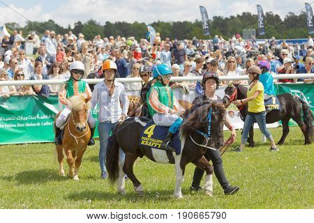 STOCKHOLM SWEDEN - JUNE 06 2017: Young jockeys warming up pony gallop race horses in the vault at Nationaldags Galoppen at Gardet. June 6 2017 in Stockholm Sweden