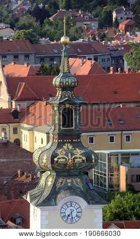 ZAGREB, CROATIA - MAY 31: Tower of the church of St. Mary with the roofs in the background in Zagreb, Croatia on May 31, 2015