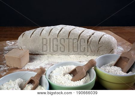 ZAGREB, CROATIA - SEPTEMBER 21: Baking bread. Dough on wooden table with flour, Zagreb, Croatia on September 21, 2016.